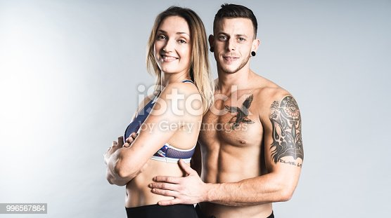 istock Athlete couple posing in studio. 996567864
