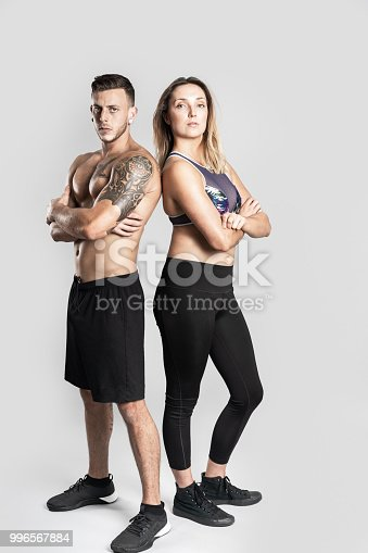 istock Athlete couple posing in studio. 996567884