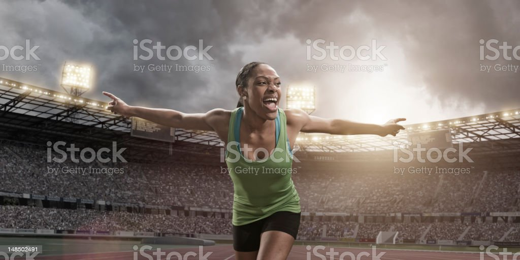 Athlete Crossing Finish Line royalty-free stock photo