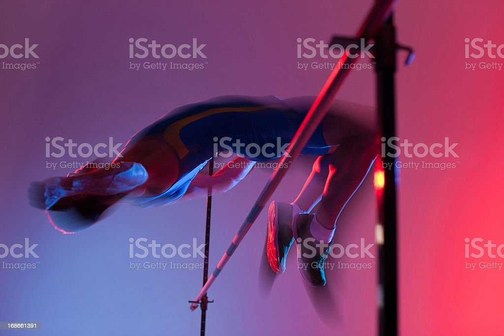 Athlete curling over high jump royalty-free stock photo