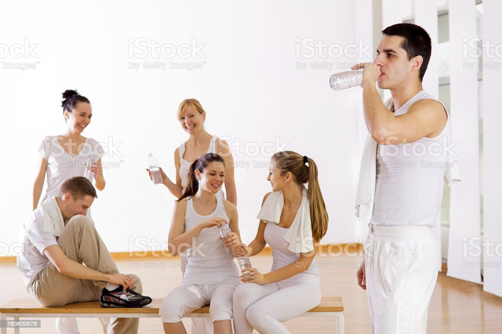 Athlete drinking water, people resting after exercising in the b royalty-free stock photo