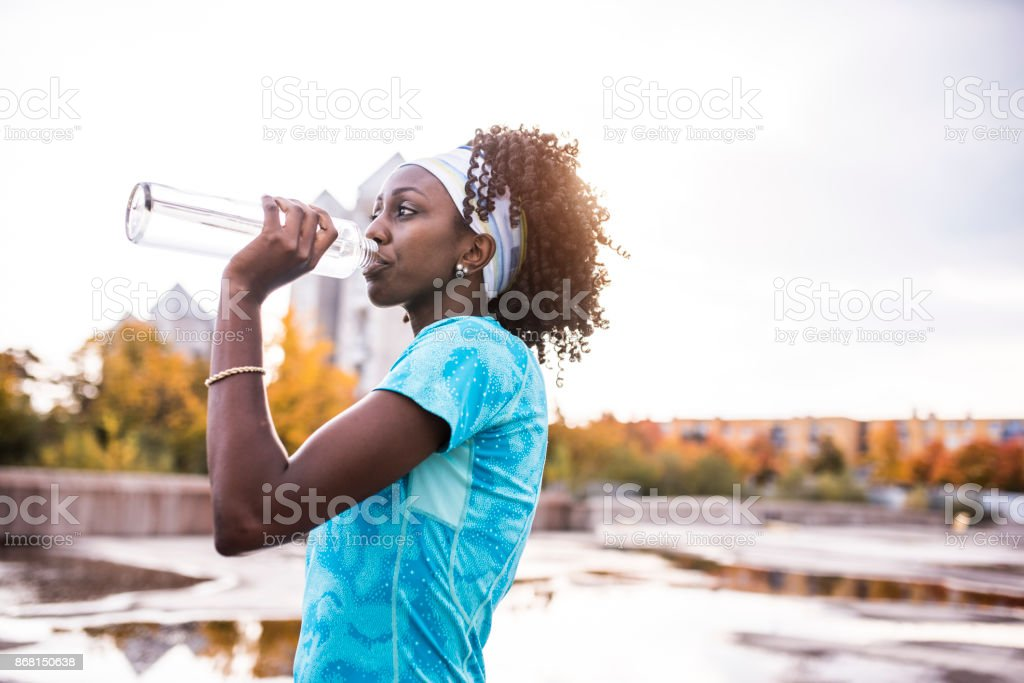 Athlete drinking water stock photo