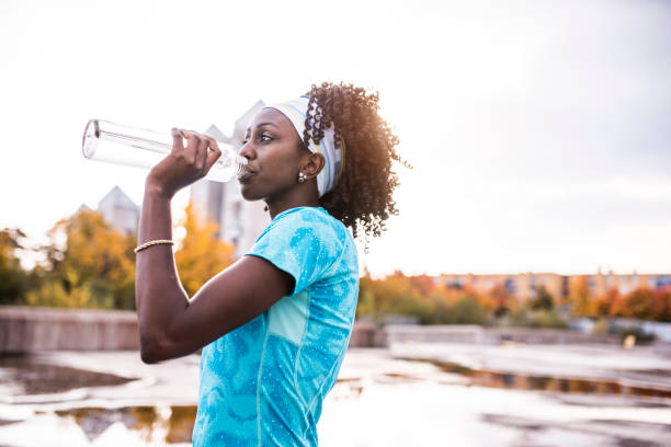 athlete drinking water - drinking water stock photos and pictures