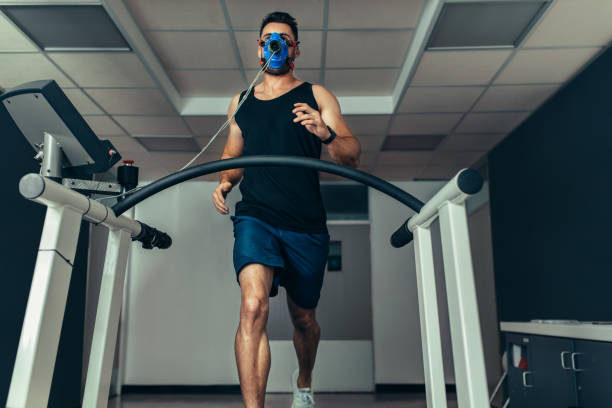 Athlete examining his fitness in sports lab stock photo