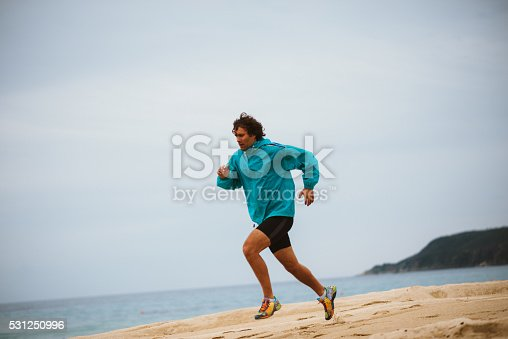 Young man has relaxation jogging training at seaside on sandy beach. Image taken with Nikon D800 and professional Nikon lens, developed from RAW in XXXL size. Location: Sithonia, Greece, South Europe, Europe