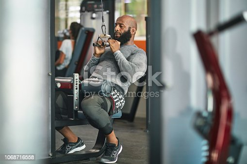 1069872470istockphoto Athlete exercising on lateral pull-down weights 1068716558
