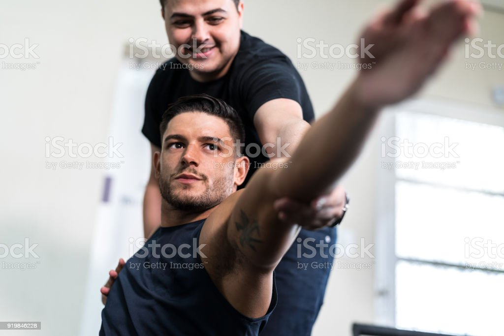 Athlete getting physical therapy stock photo