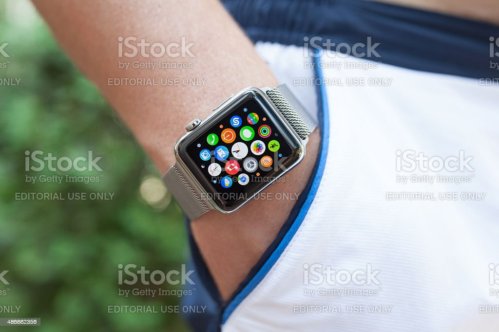 Athlete hand with Apple Watch and app icon on screen stock photo