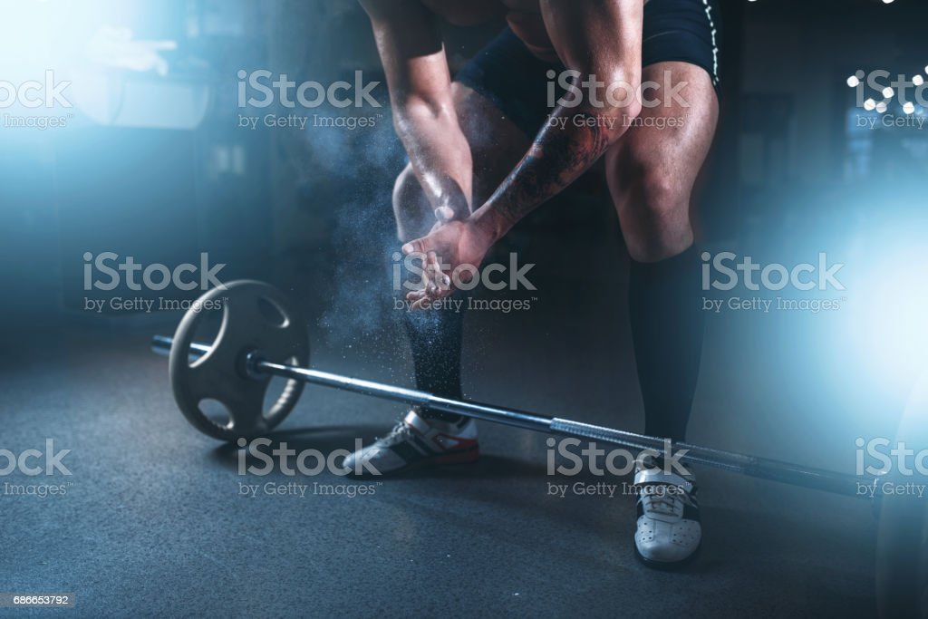 Athlete hands in powder and talc, barbell exercise royalty-free stock photo