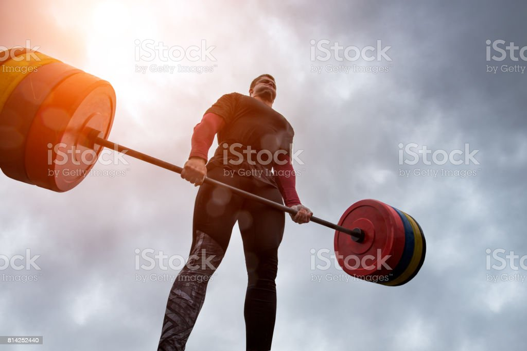 athlete have difficulty holding a heavy barbell stock photo