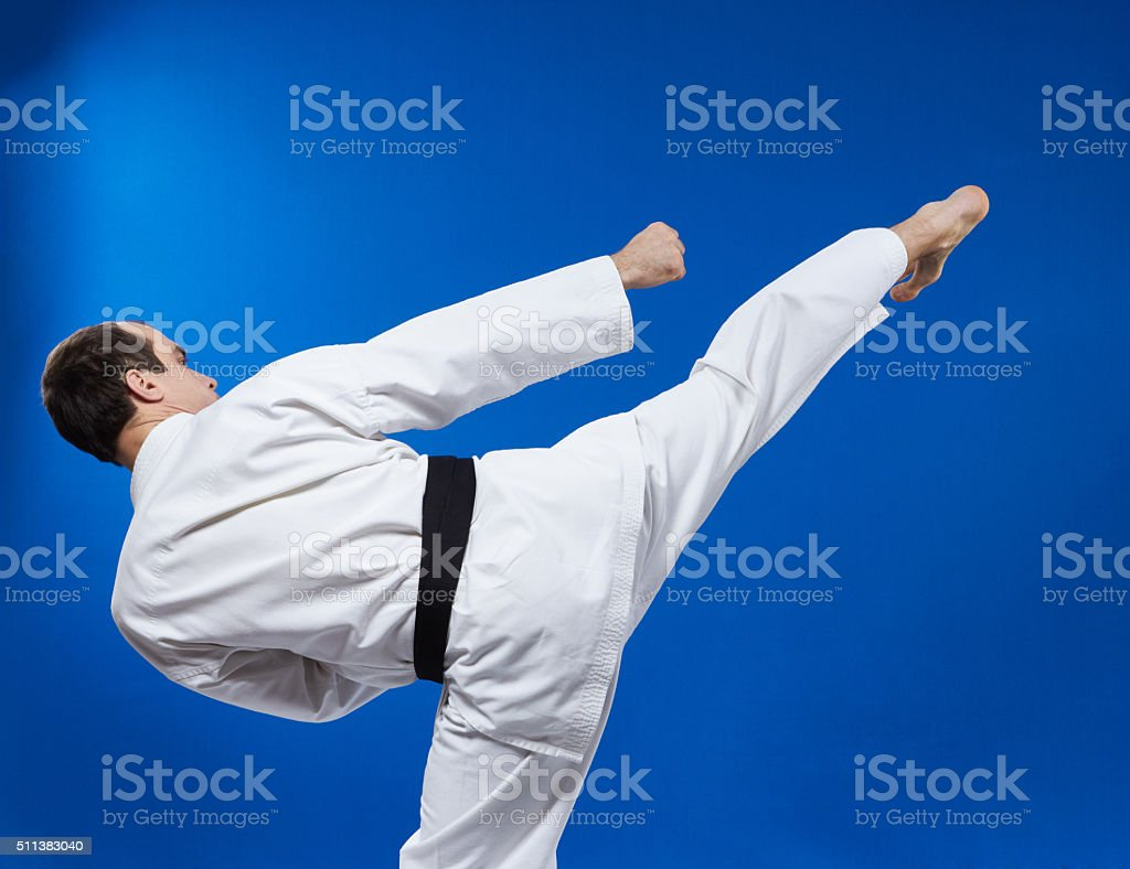 Athlete hits a kick to the side stock photo