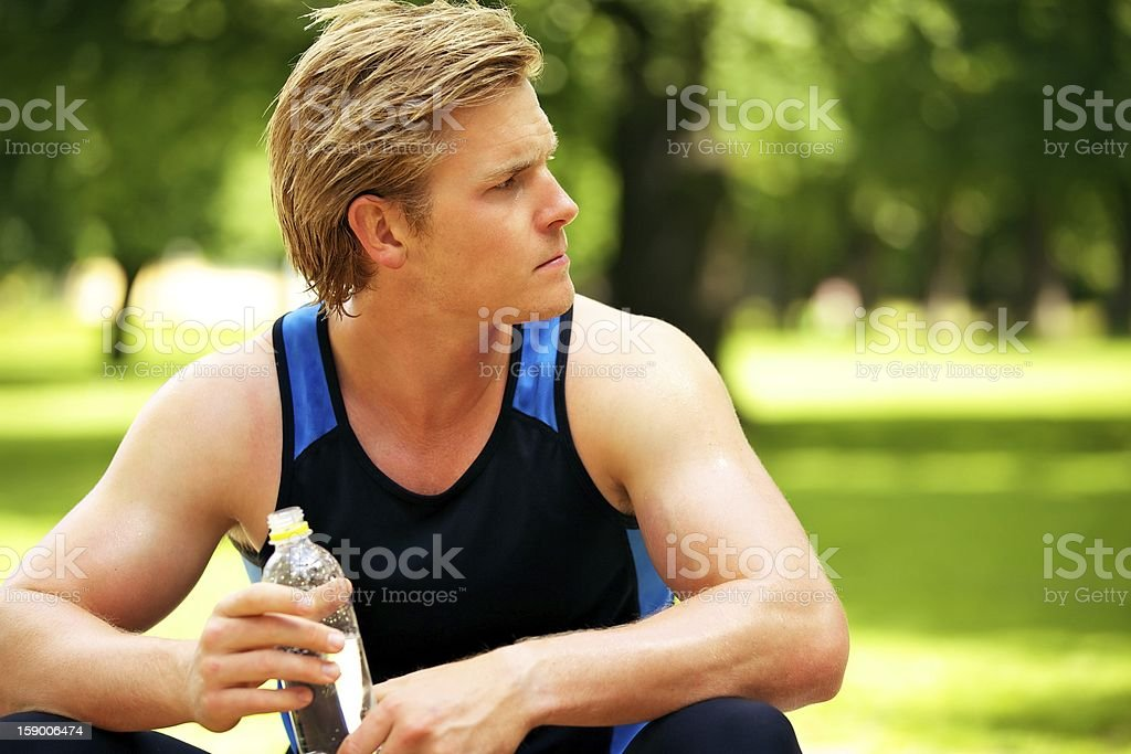 Athlete Holding a Water Bottle royalty-free stock photo