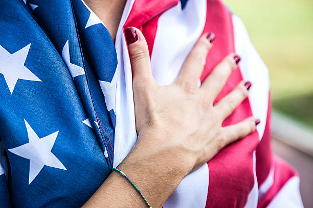 us athlete holding national flag - national anthem stock photos and pictures