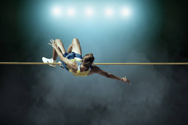 athlete in action of high jump. - leichtathletik stock-fotos und bilder