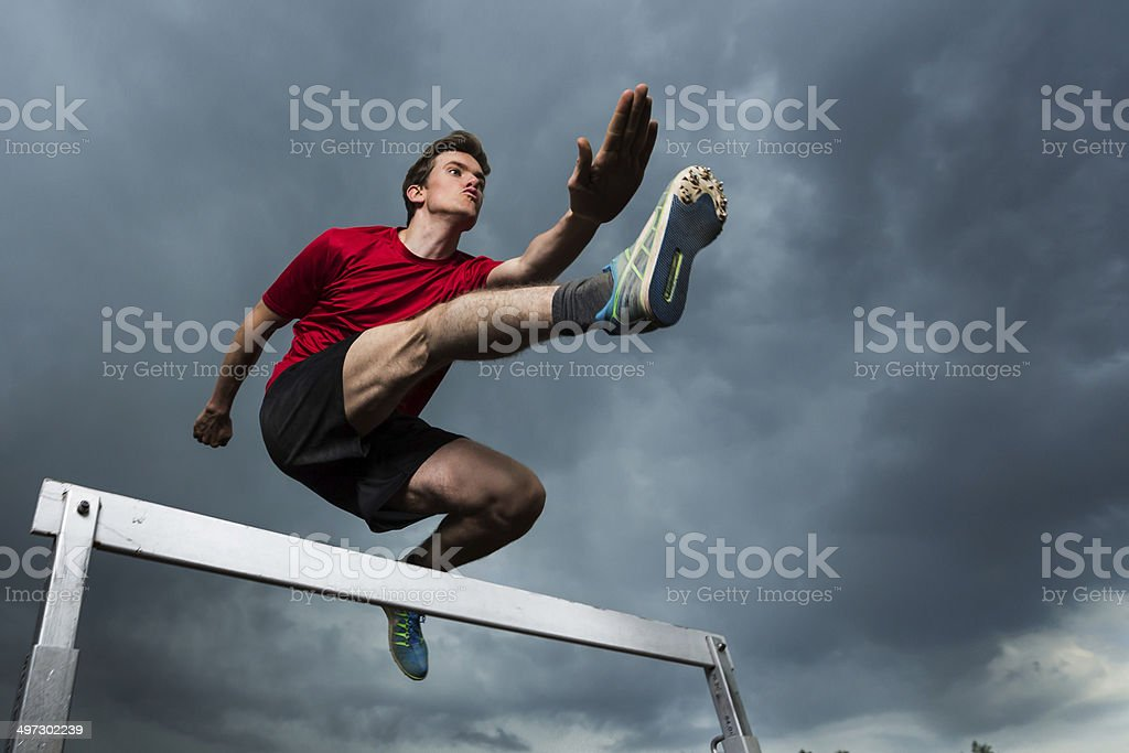athlete in hurdling stock photo