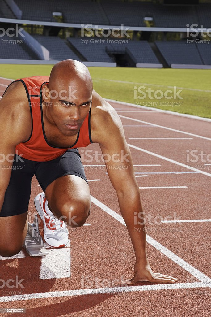 Athlete in start position on running track royalty-free stock photo