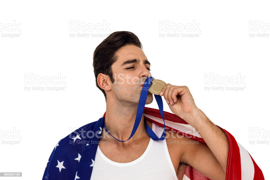 Athlete kissing gold medal after victory royalty-free stock photo