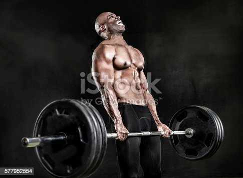 Athlete lifting heavy weights.