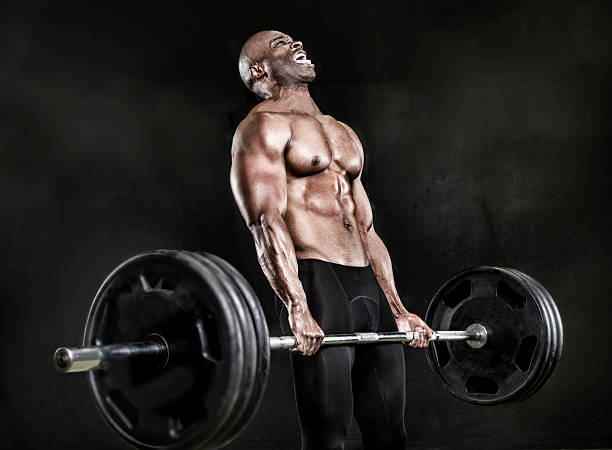 Athlete lifting heavy weights – Foto