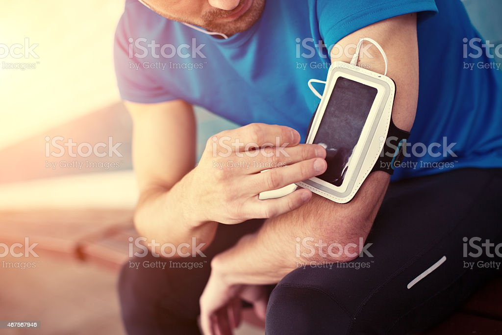 athlete listening music stock photo