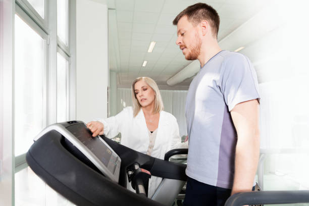 athlete on a treadmill with physiotherapist doctor - sports medicine stock pictures, royalty-free photos & images