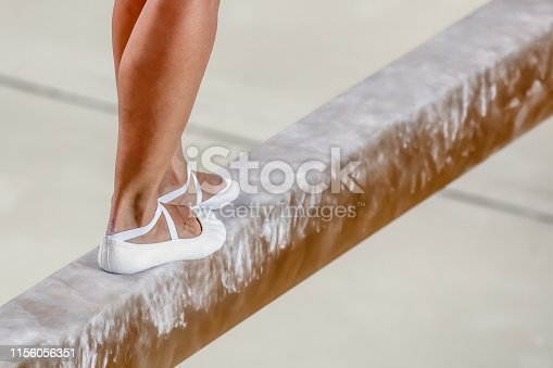 Athlete on balance beam in gymnastics competitions
