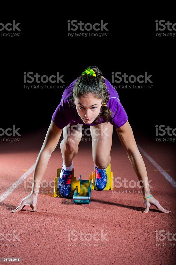 Athlete on the starting block stock photo