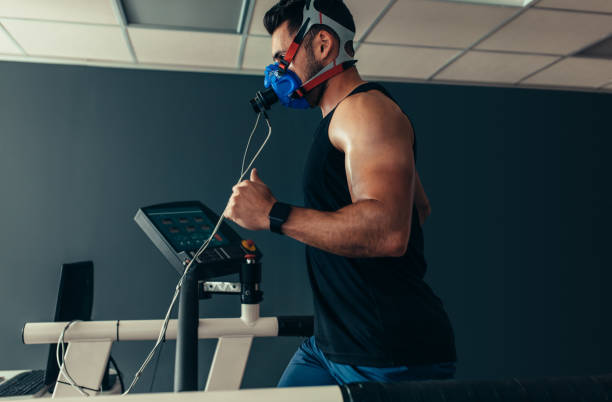 Athlete on treadmill at sports science lab stock photo