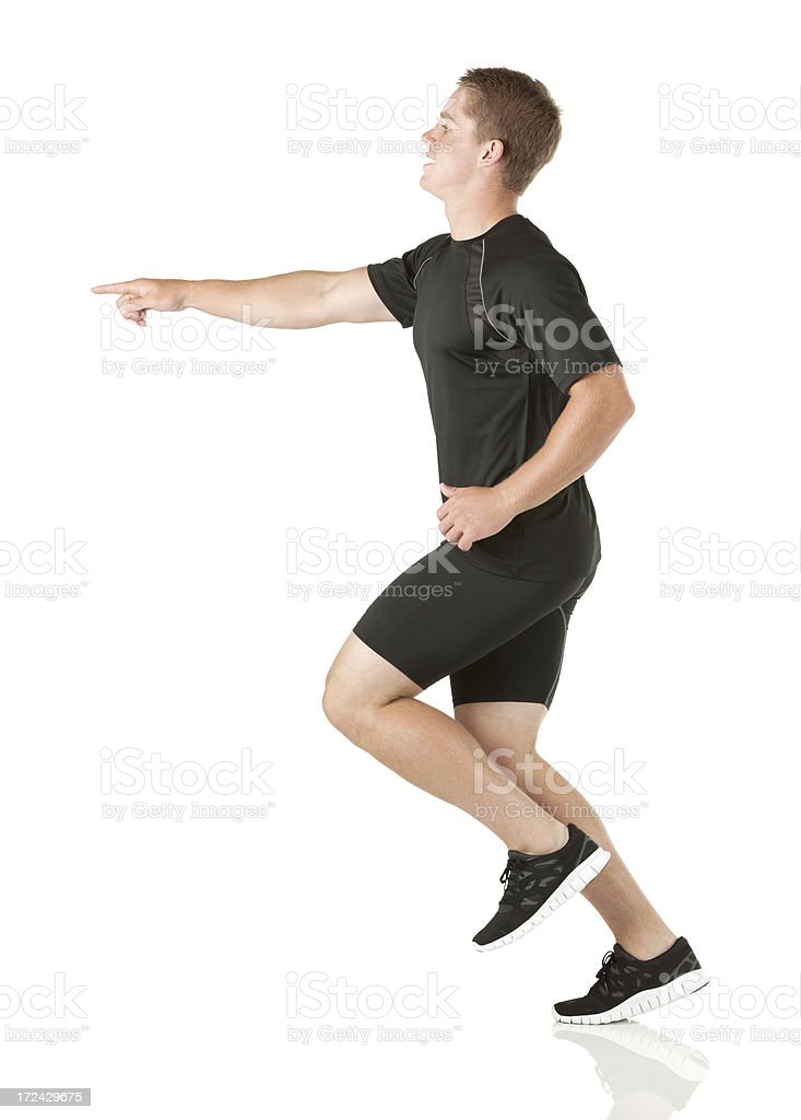 Athlete pointing forward and running royalty-free stock photo