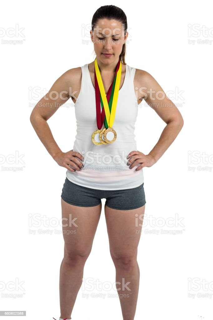 Athlete posing with gold medals around his neck royalty-free stock photo