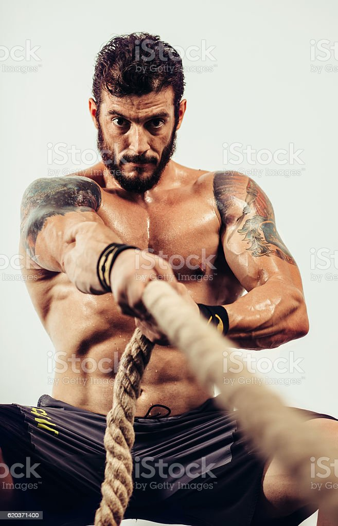 Athlete pulls a rope foto de stock royalty-free