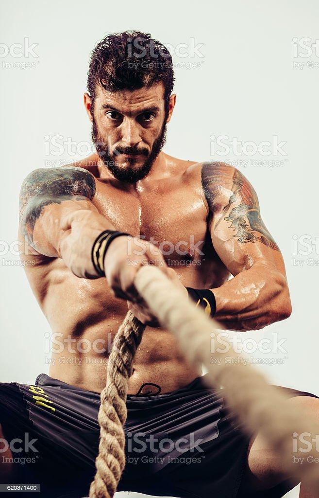 Athlete pulls a rope zbiór zdjęć royalty-free
