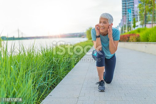 497687118istockphoto Athlete runner in sportswear relaxing getting inspired. 1157173718