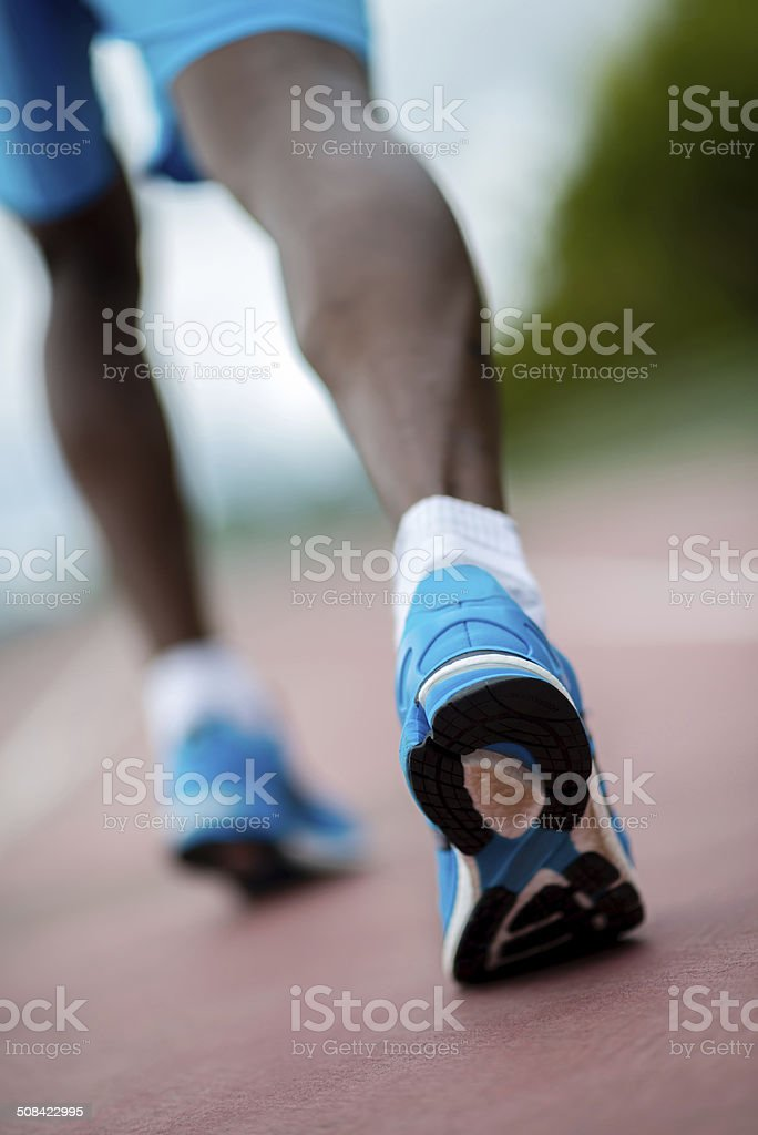 Athlete running at the track stock photo