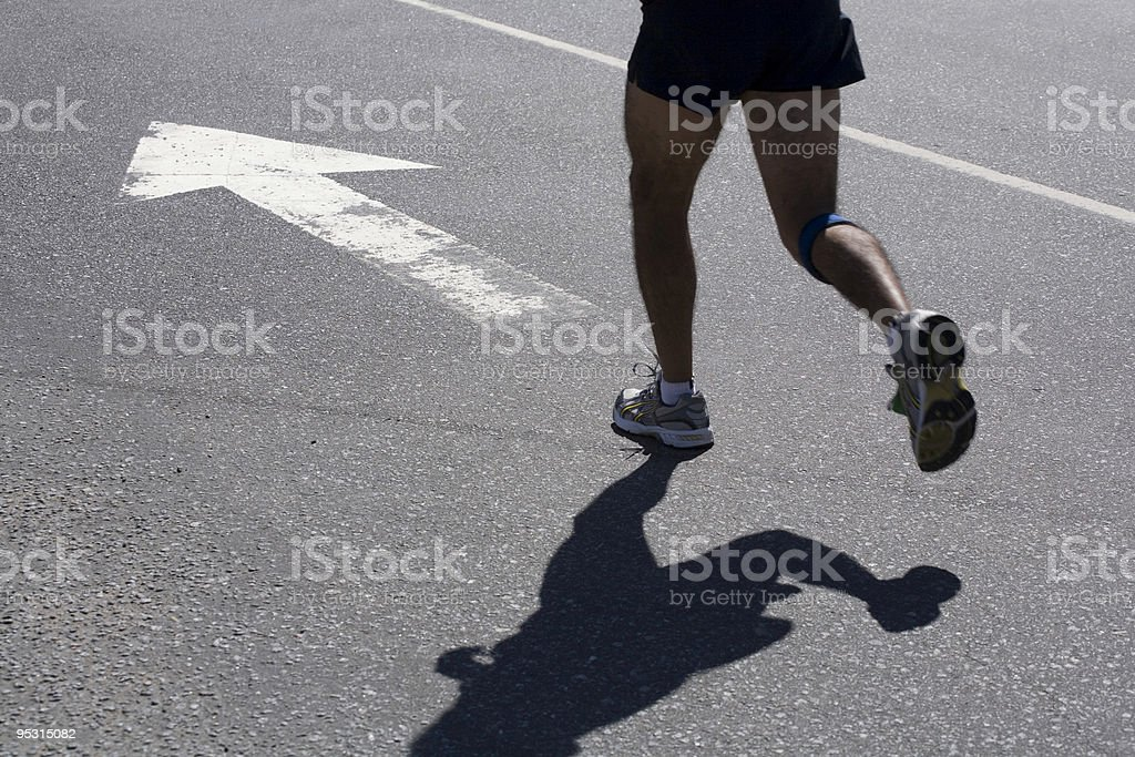 Athlete running in the city royalty-free stock photo