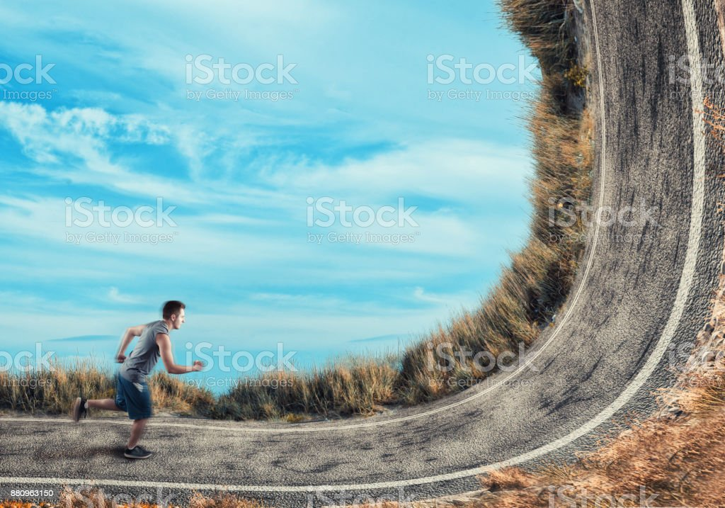 Athlete running on a bend road. stock photo
