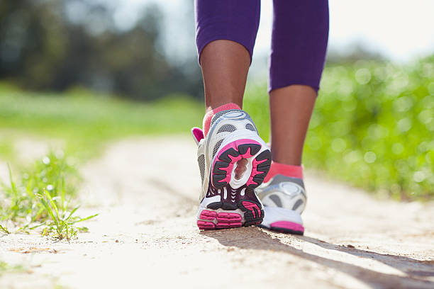 Athlete Running. feet of an athlete running at the park.  women's track stock pictures, royalty-free photos & images