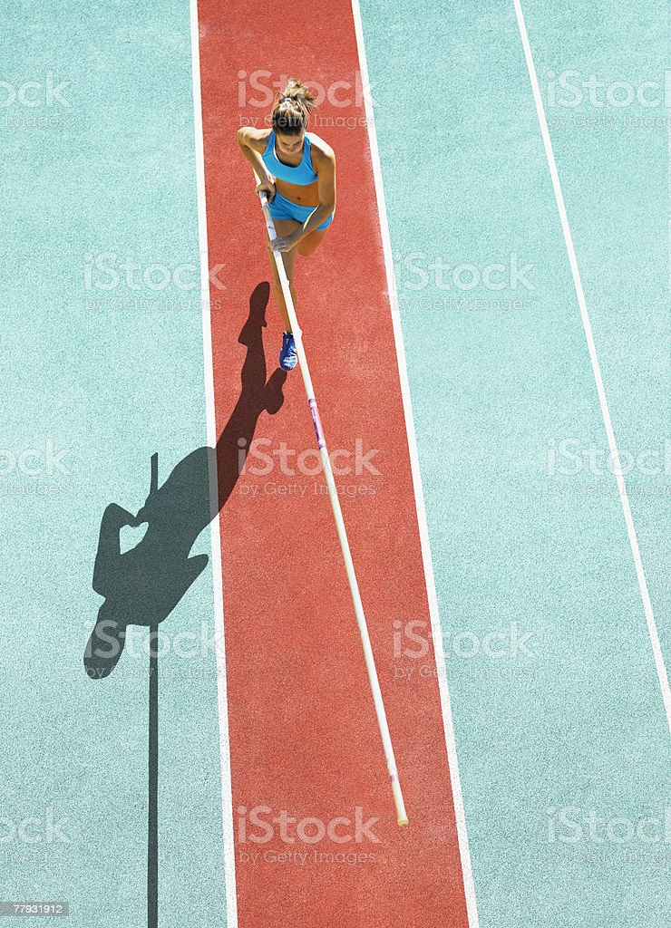 Athlete running to do a pole vault stock photo