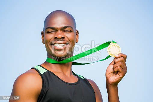 istock Athlete showing his gold medal 663211306