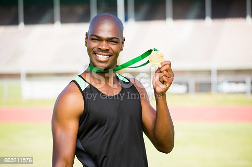 istock Athlete showing his gold medal 663211576