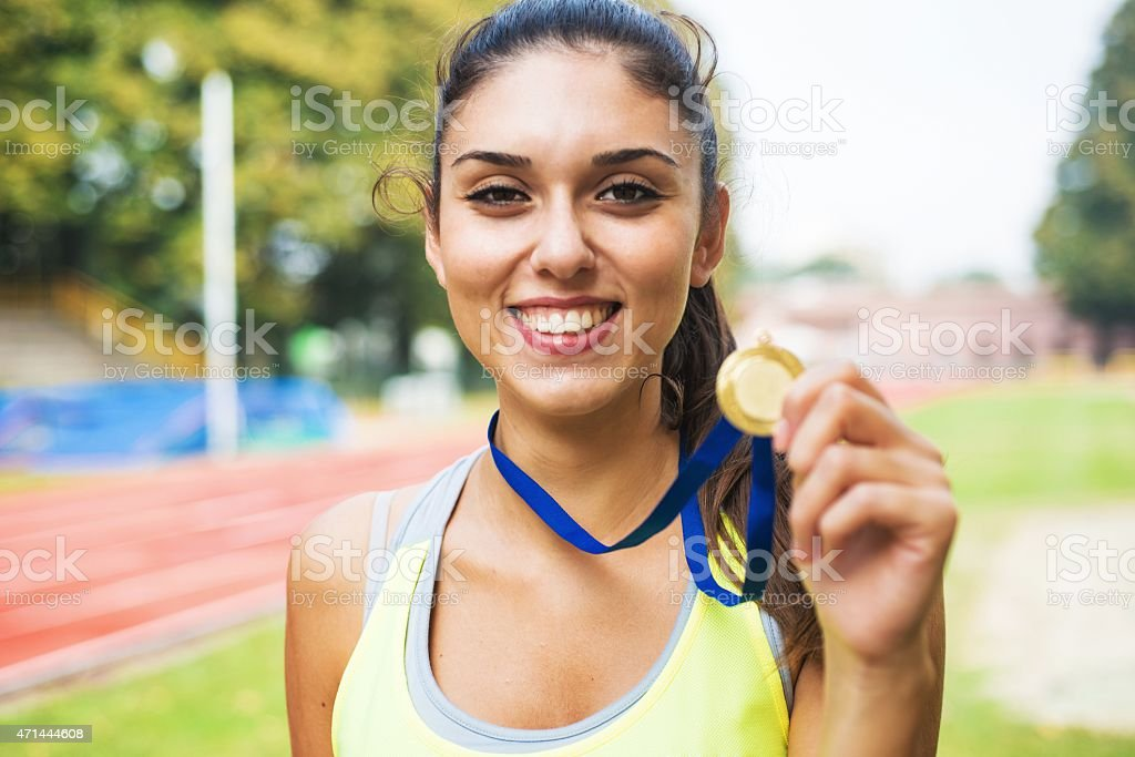 Athlete showing medals stock photo