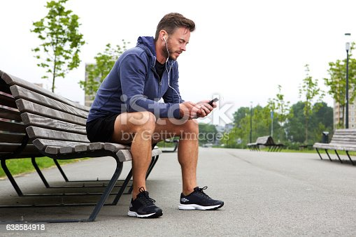 istock Athlete sitting listening to music outside 638584918