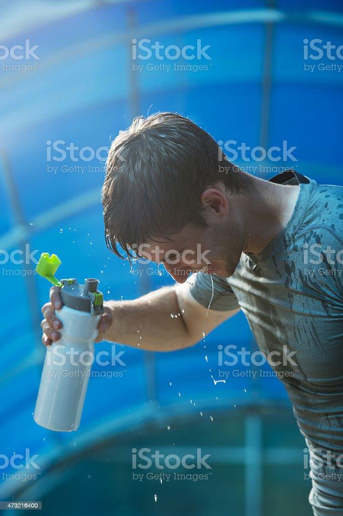 Athlete splashing pouring water head stock photo