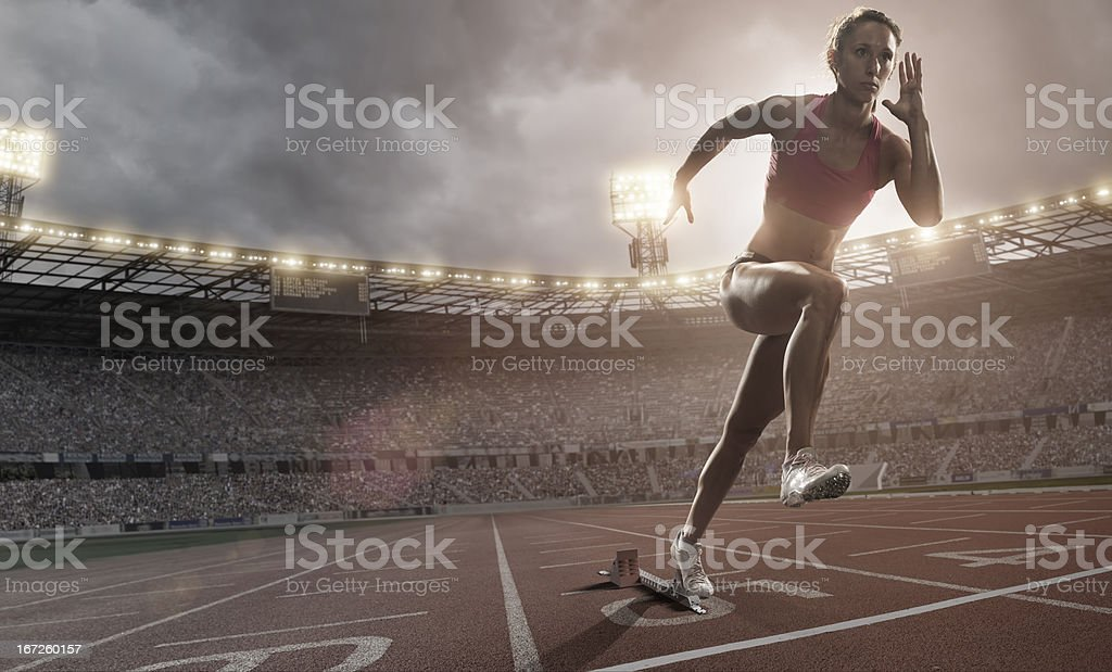 Athlete Sprinting Out Of Blocks stock photo