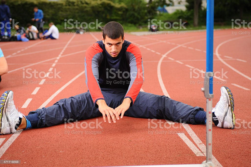 Athlete streching royalty-free stock photo