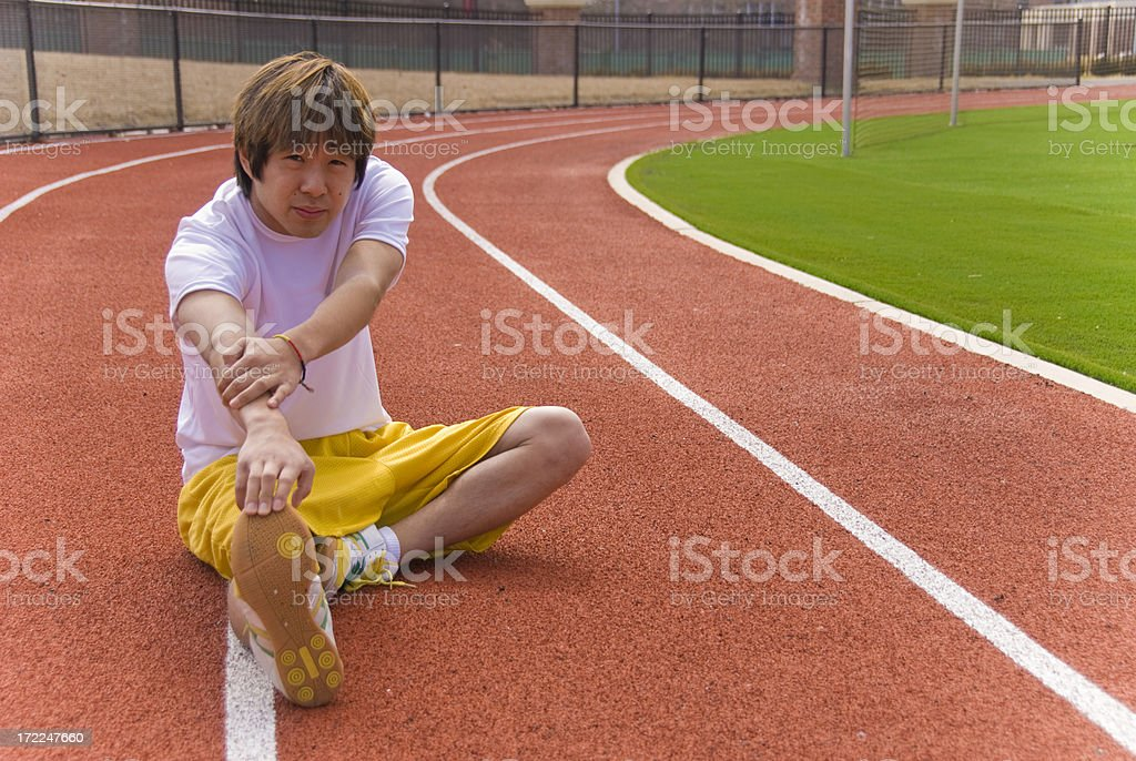 athlete stretching royalty-free stock photo