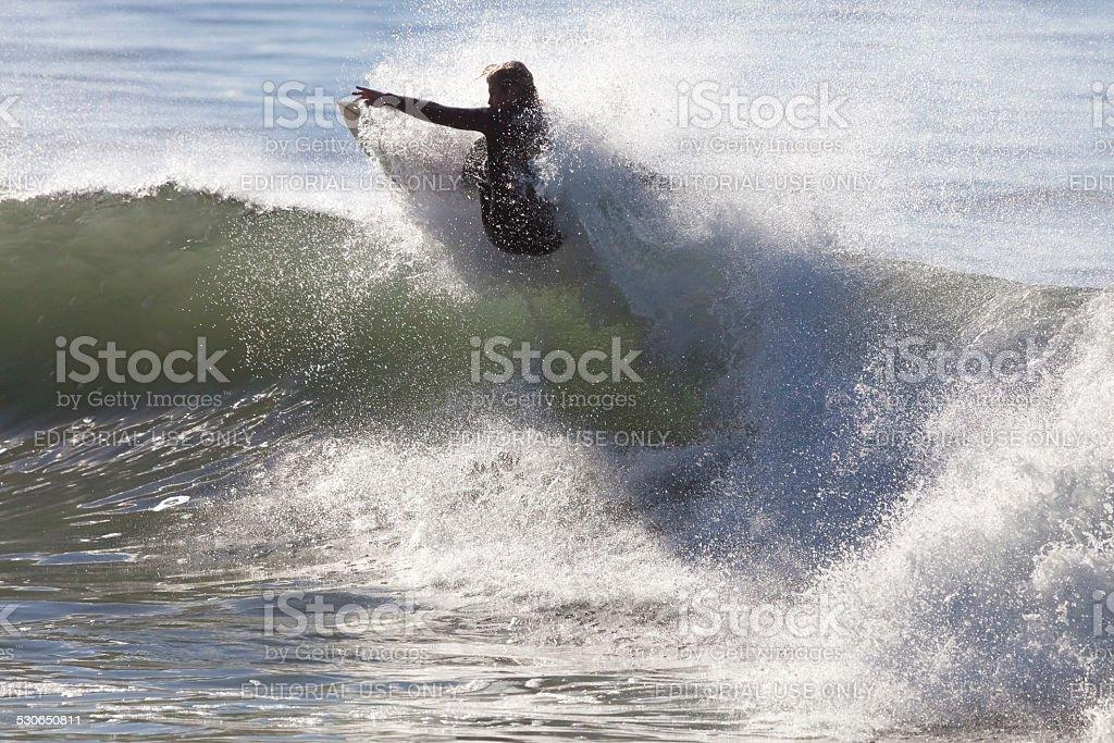Athlete Surfing On Santa Cruz Beach In California Stock