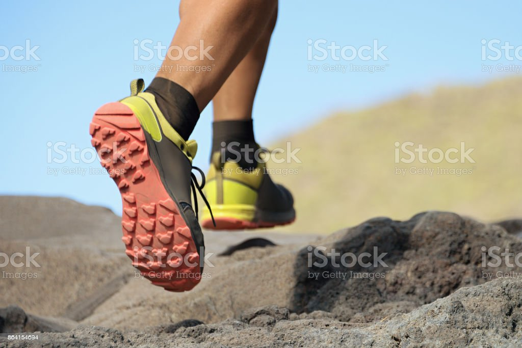 Athlete trail running in the mountains royalty-free stock photo