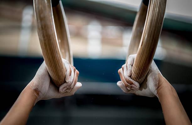 Athlete using gymnastics rings stock photo