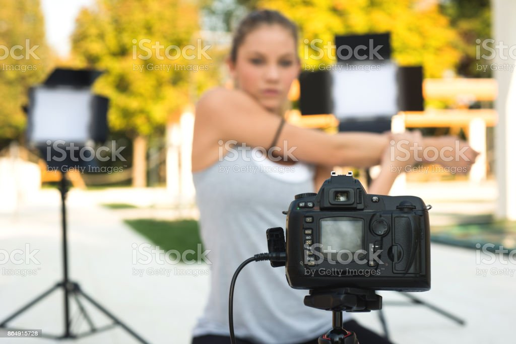 Athlete Vlogger making a video stock photo